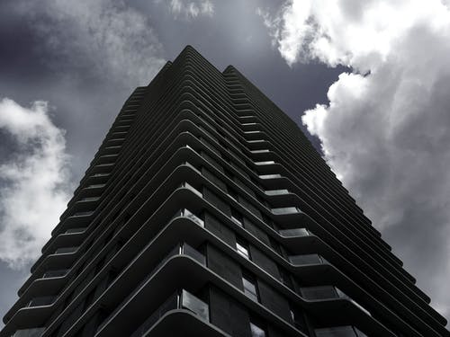 Black City Building Under White and Gray Clouds