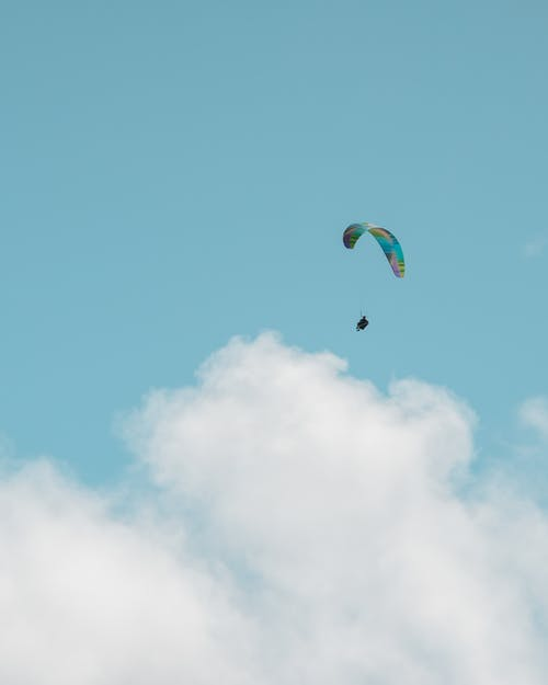 Person in Parachute Under Blue Sky