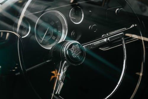 Black Car Steering Wheel With Black and Silver Steering Wheel
