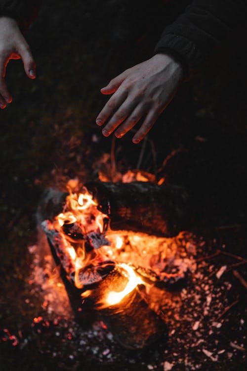 Hands Over a Bonfire