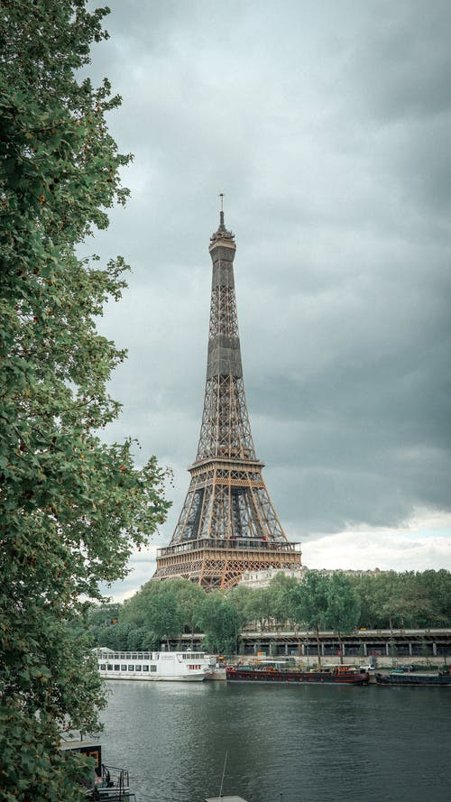 Cruise ships floating on river near Eiffel Tower