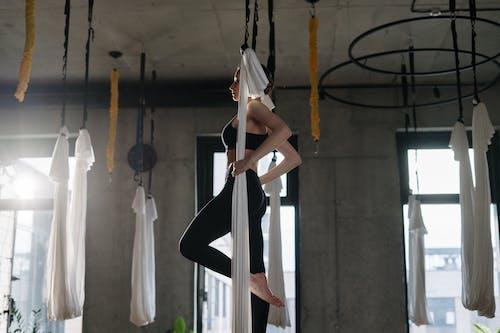 Woman in White Dress Hanging on Black Metal Frame
