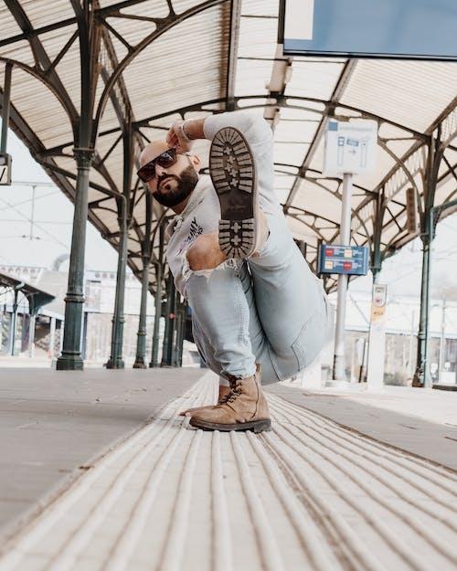 Cool man break dancing on platform
