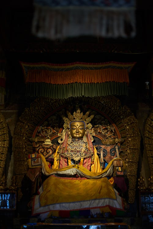 Golden Buddha statue in old monastery