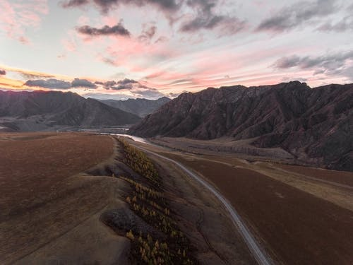 Road among textural mountains and valley
