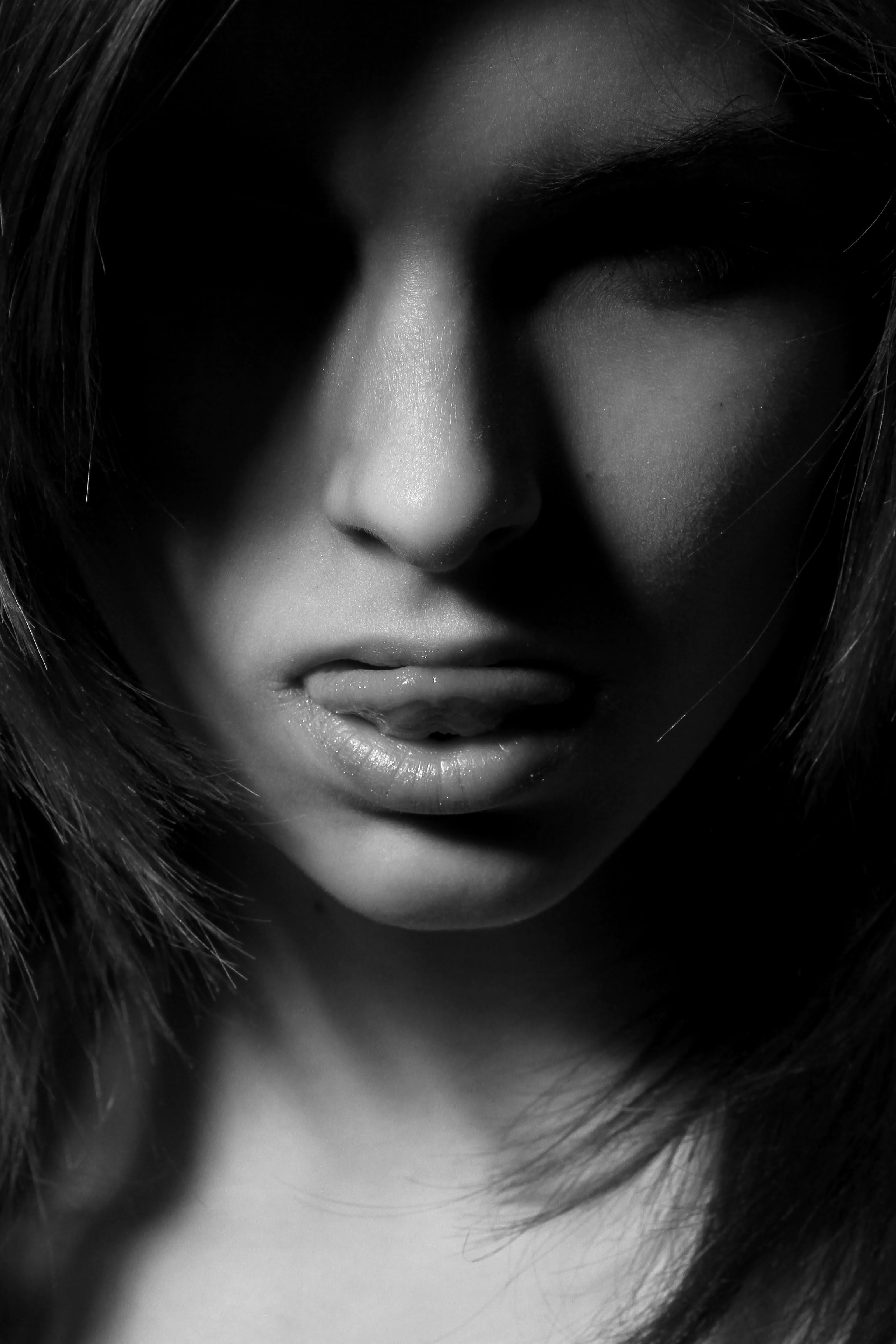 Grayscale Photography of Woman Sticking Her Tongue Out