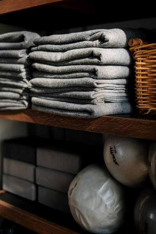 Gray Textile on Brown Wooden Shelf
