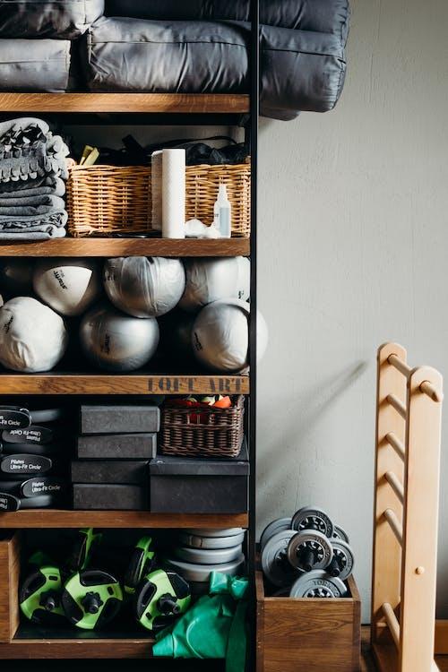 White Ceramic Vase on Brown Wooden Shelf