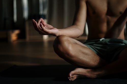 Man in Black Shorts Sitting on Floor