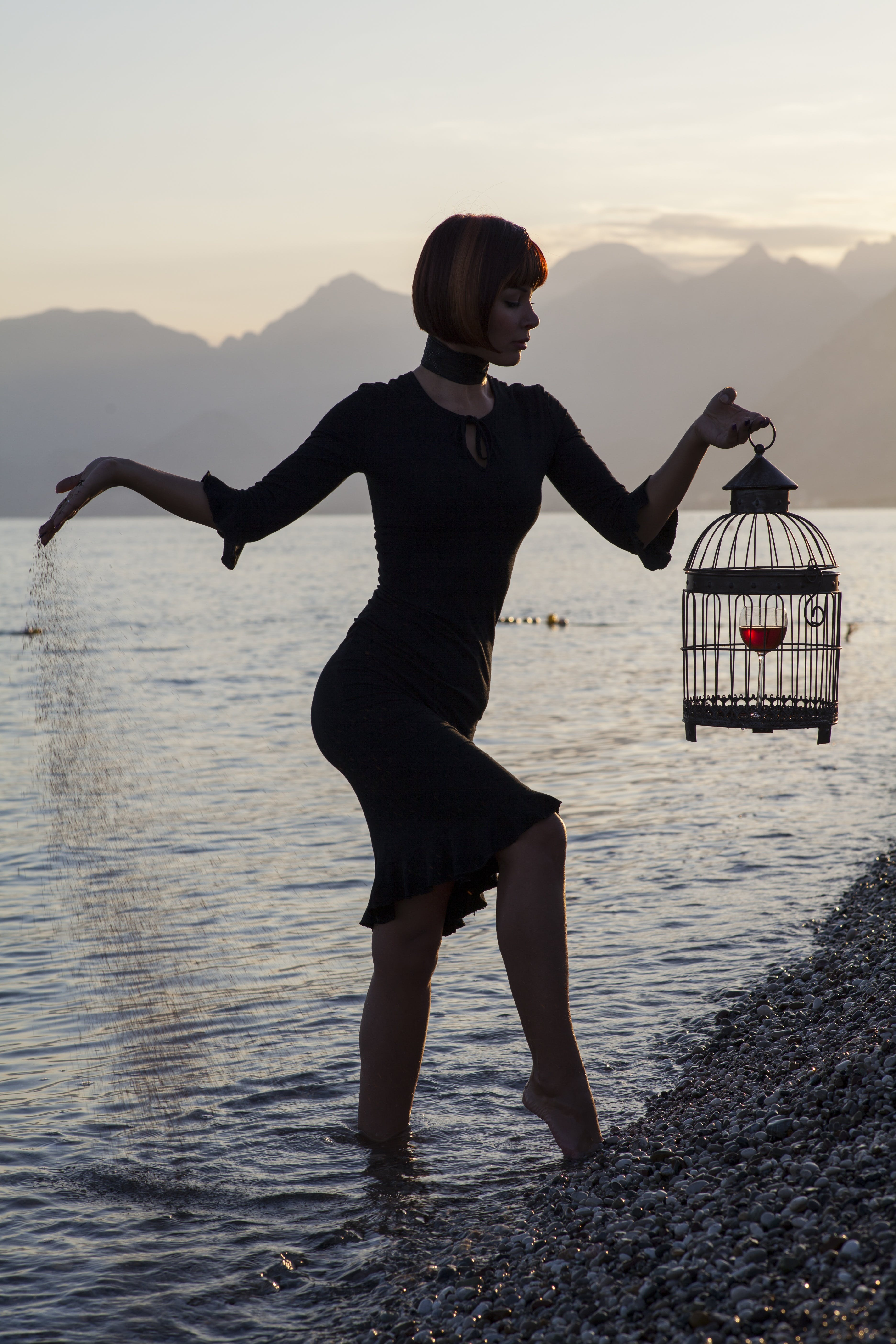Woman Carrying Birdcage