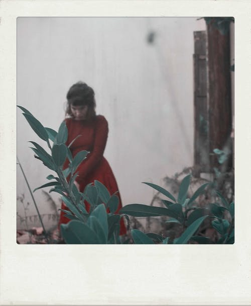 Retro photo of woman in garden