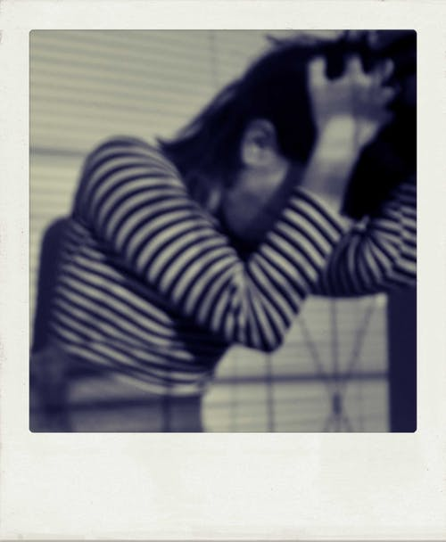 Retro shot of anxious anonymous woman