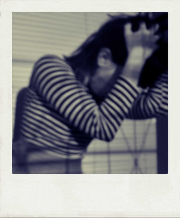 Retro shot of anxious anonymous woman