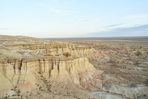 Breathtaking view of Tsagaan Suvarga textured canyon and vast Mongolian desolate lands under clear blue sky