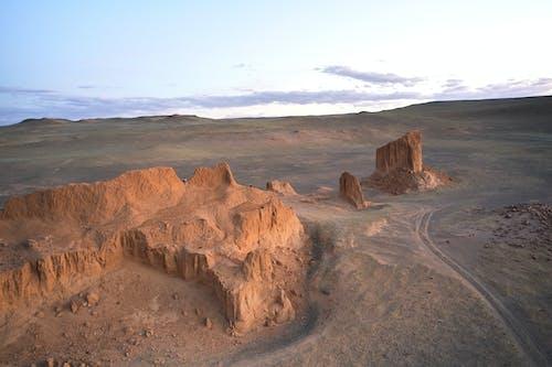 Rocky formations in desert under serene sky