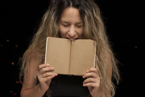 Woman Biting Book