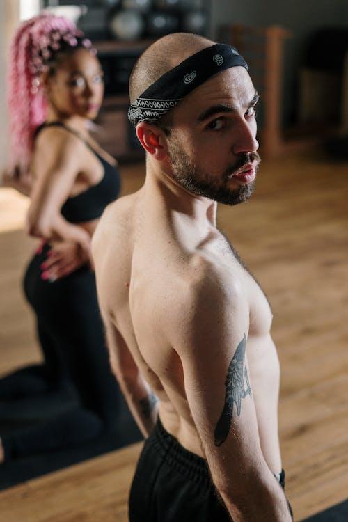 Topless Man Wearing Black Cap