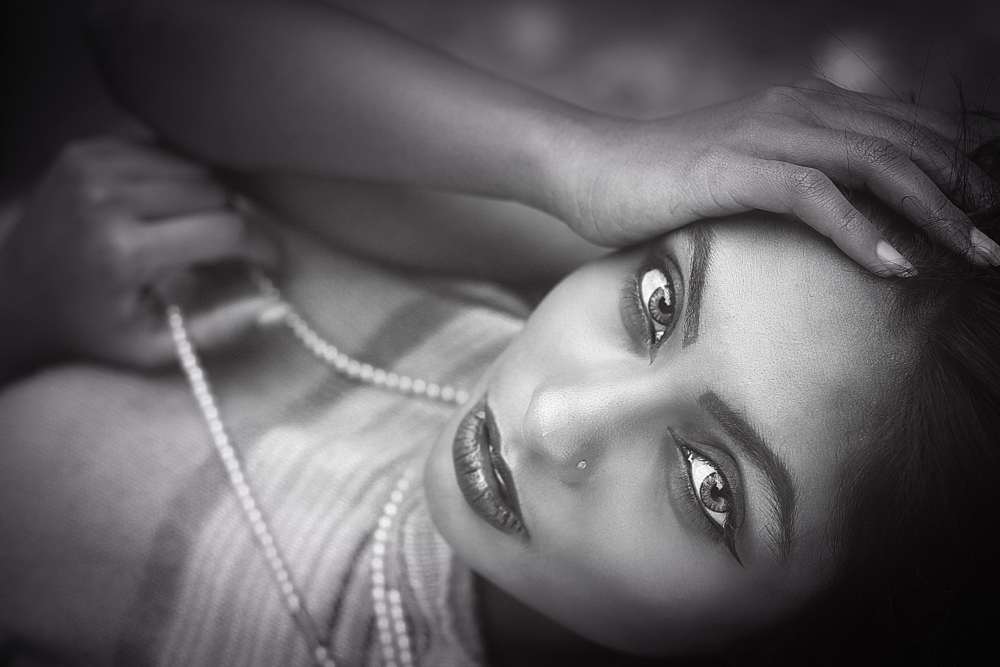 Grayscale Photography of Woman Touching Her Forehead