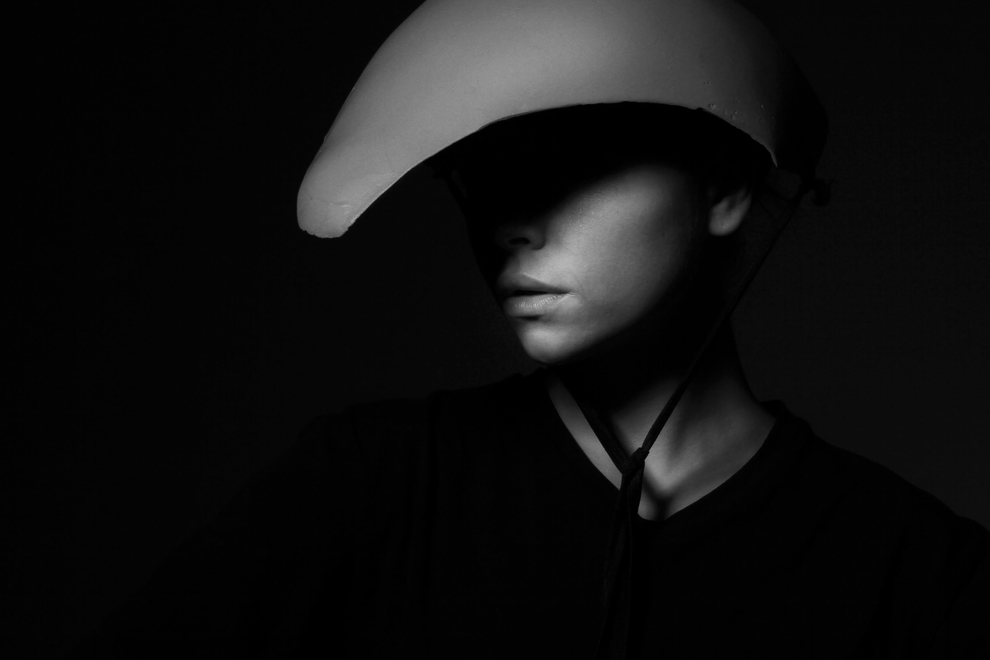 Grayscale Photography of Person Wearing Hat