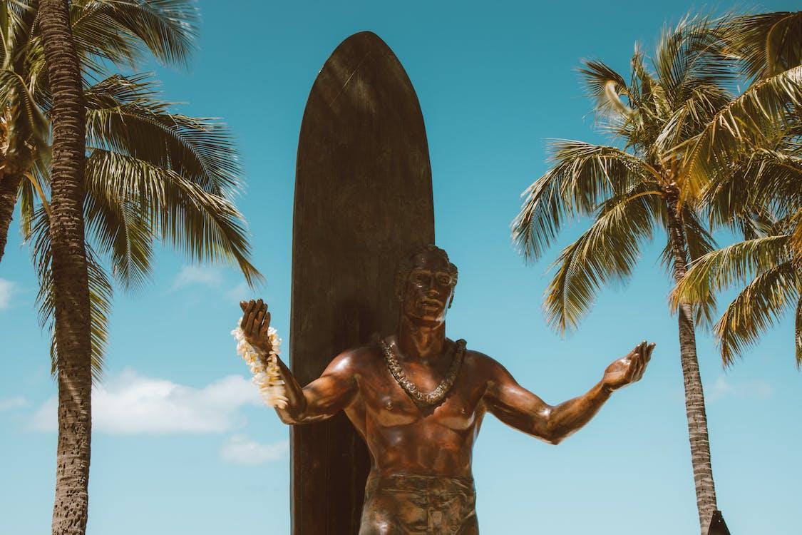 Man Statue Under Blue Sky