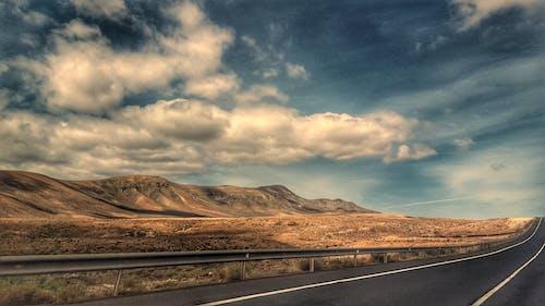 Foto stok gratis alam, aspal, awan, gurun pasir