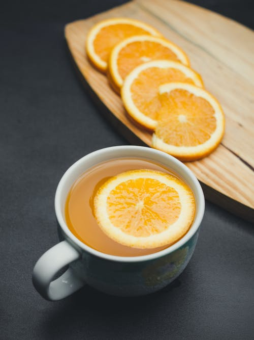 White Cup and Sliced Orange