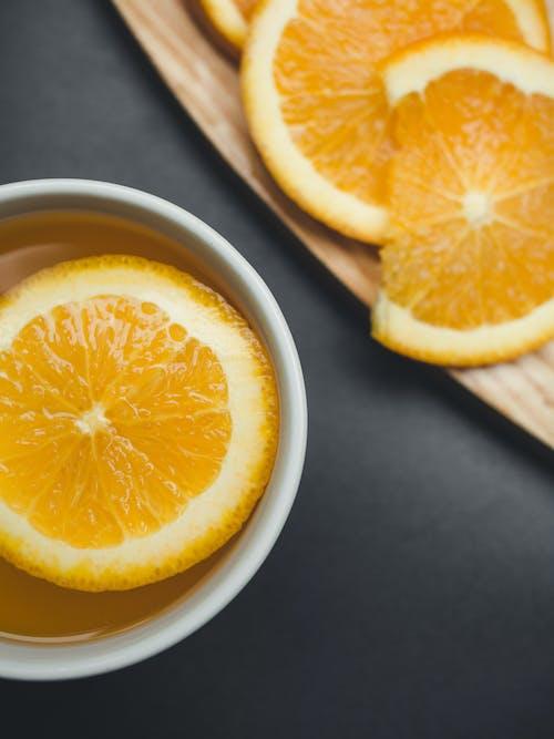 Sliced Orange in White Ceramic Mug