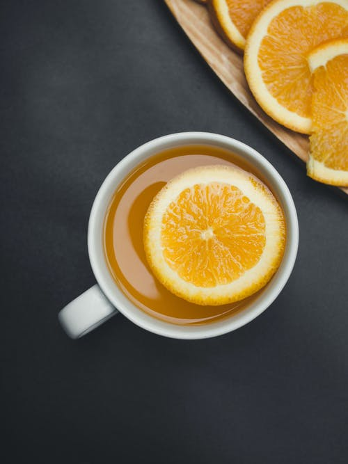 White Ceramic Mug With Orange Juice