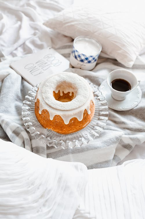 White Ceramic Cup on White Saucer