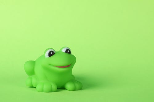 Free stock photo of green background, green frog, plastic toy