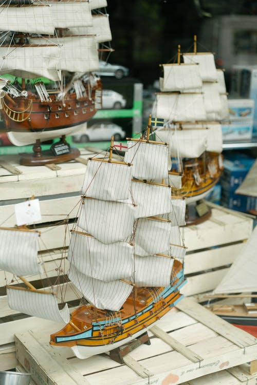 From above of handcraft wooden miniature of sailing ship in showcase of souvenir store