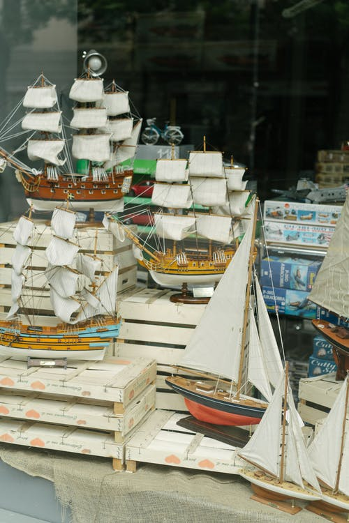 Collection of souvenir boats in showcase of store