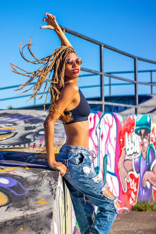 Extravagant stylish black woman on street