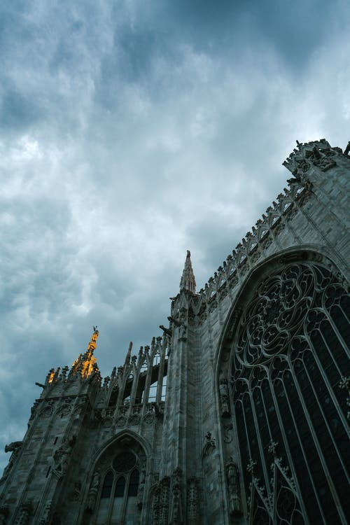 Part of Milan Cathedral exterior on dark evening