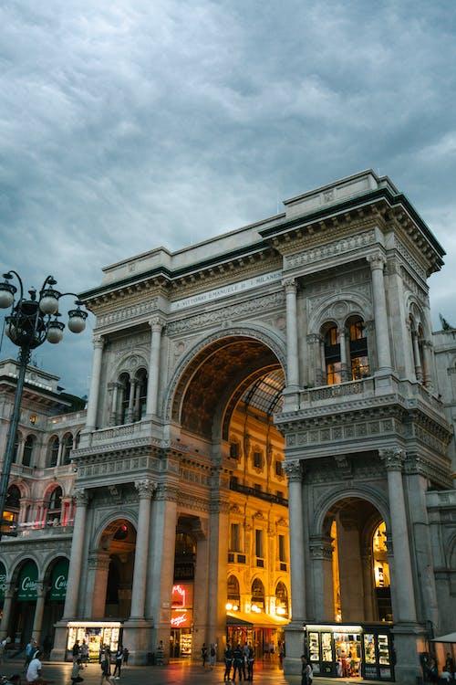 Galleria Vittorio Emanuele II in Milan under grey evening sky