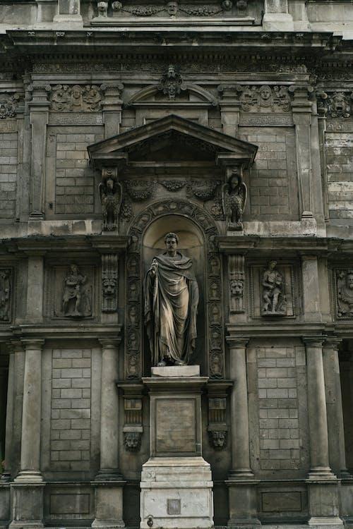 Stone facade of Fabricio Bossio Clock Tower in Milan