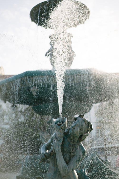 Magnificent Baroque fountain on Rossio Square in Lisbon