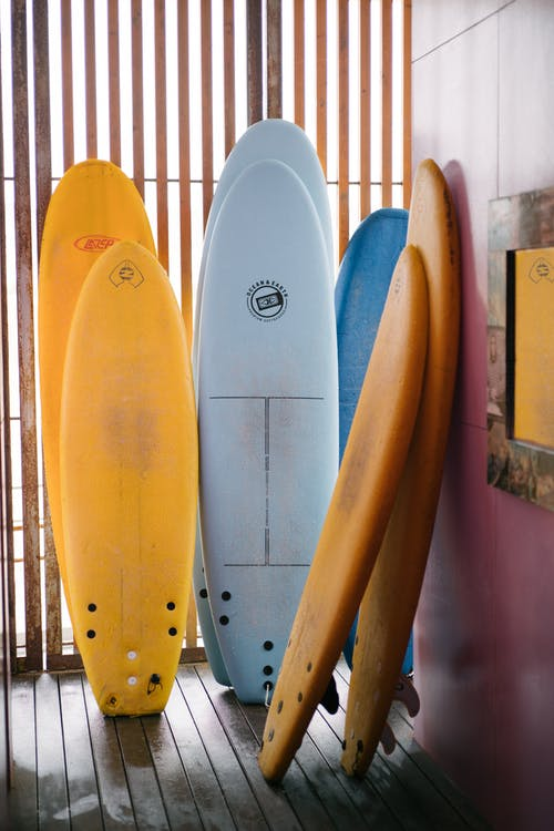 Colorful surfboards of different sizes