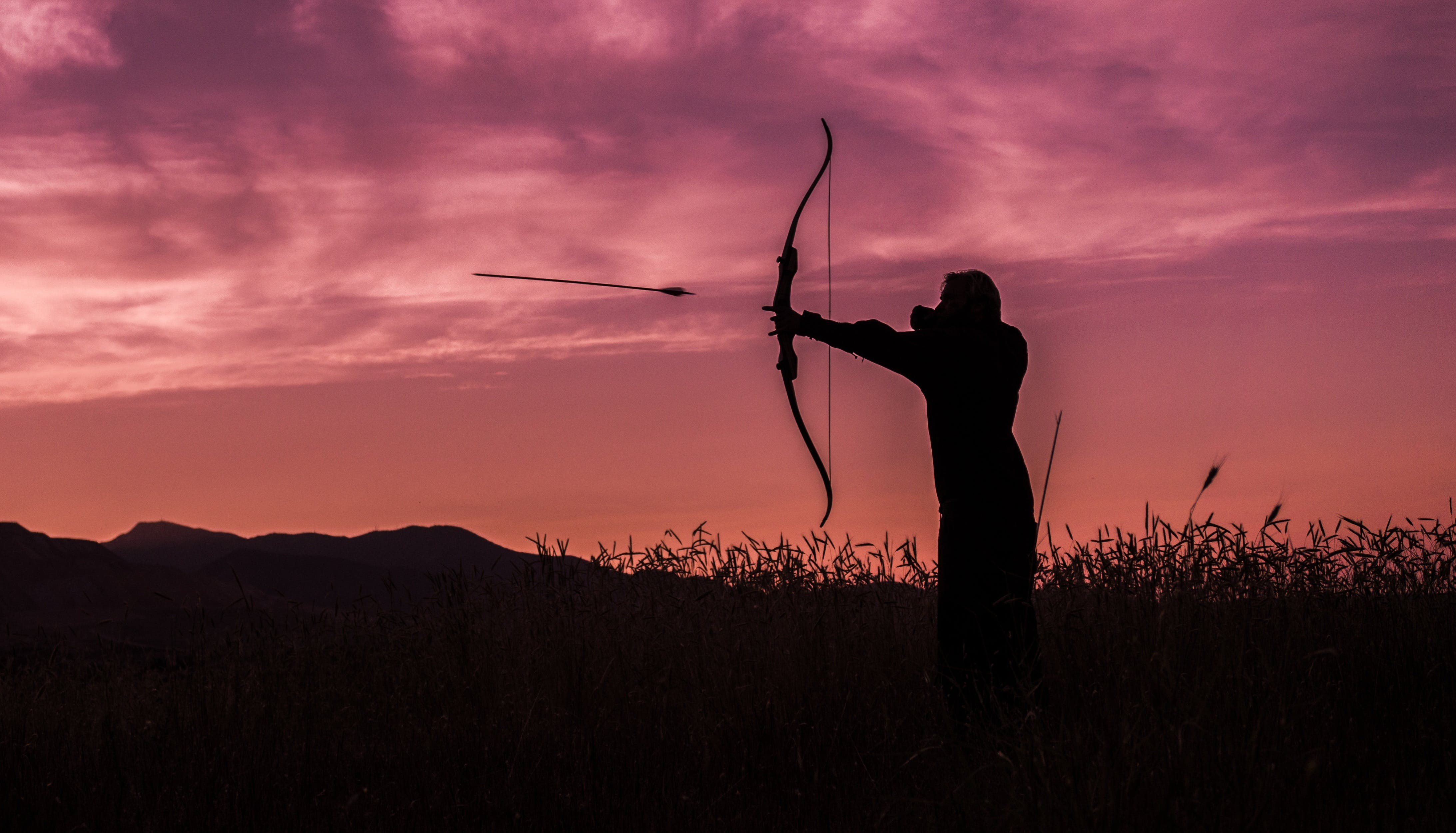Person Shooting Arrow from Bow