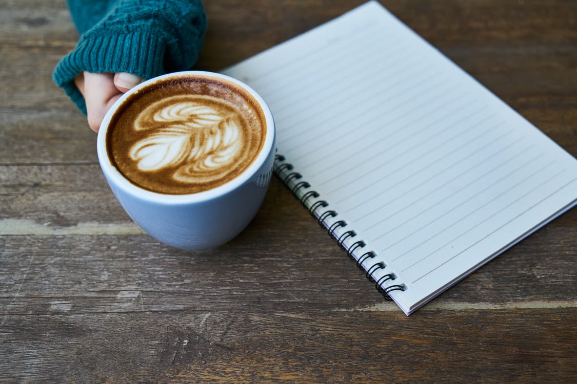Blue Teacup Beside White Ruled Paper