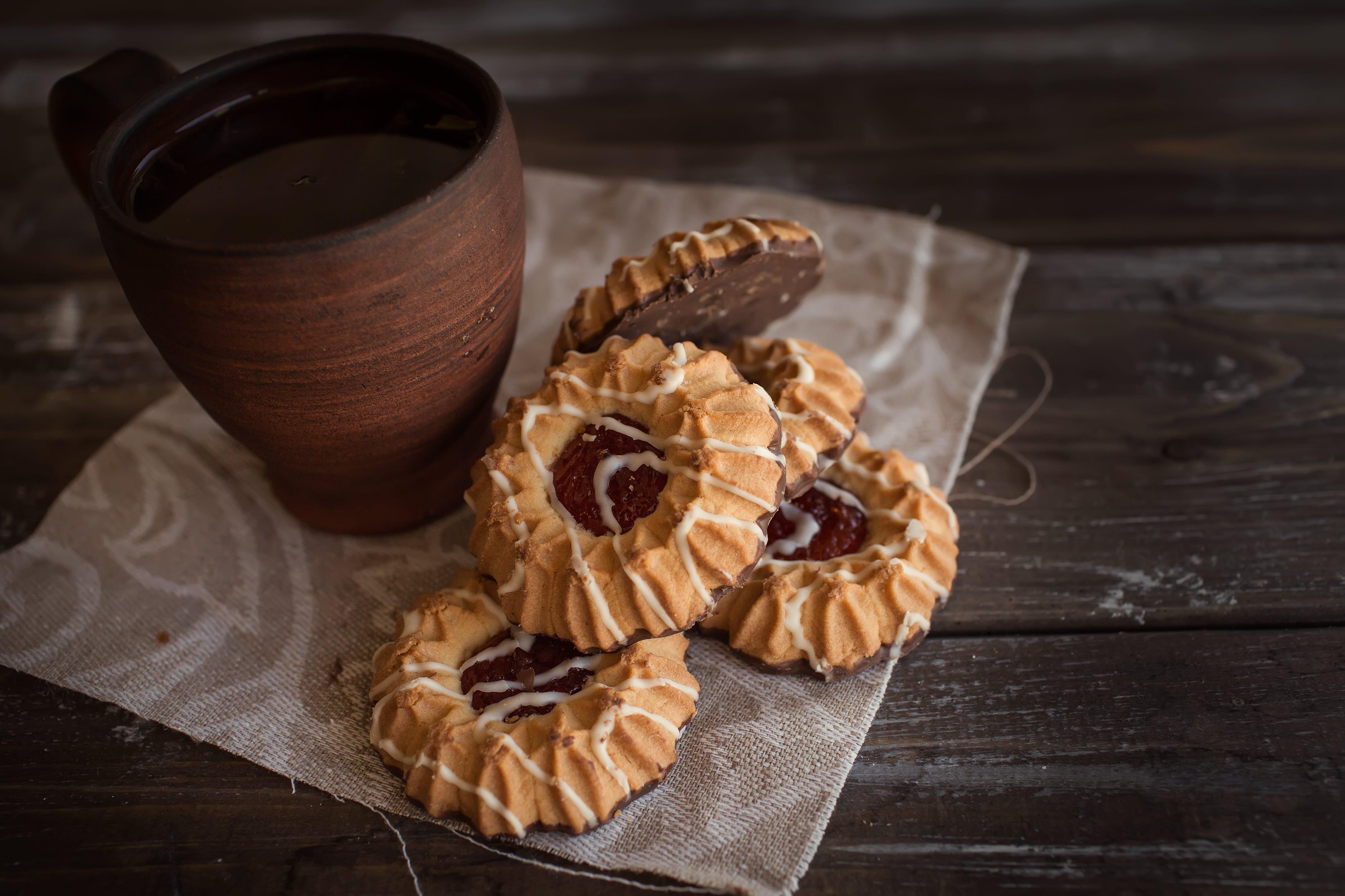 Brown Mug Beside Cookies