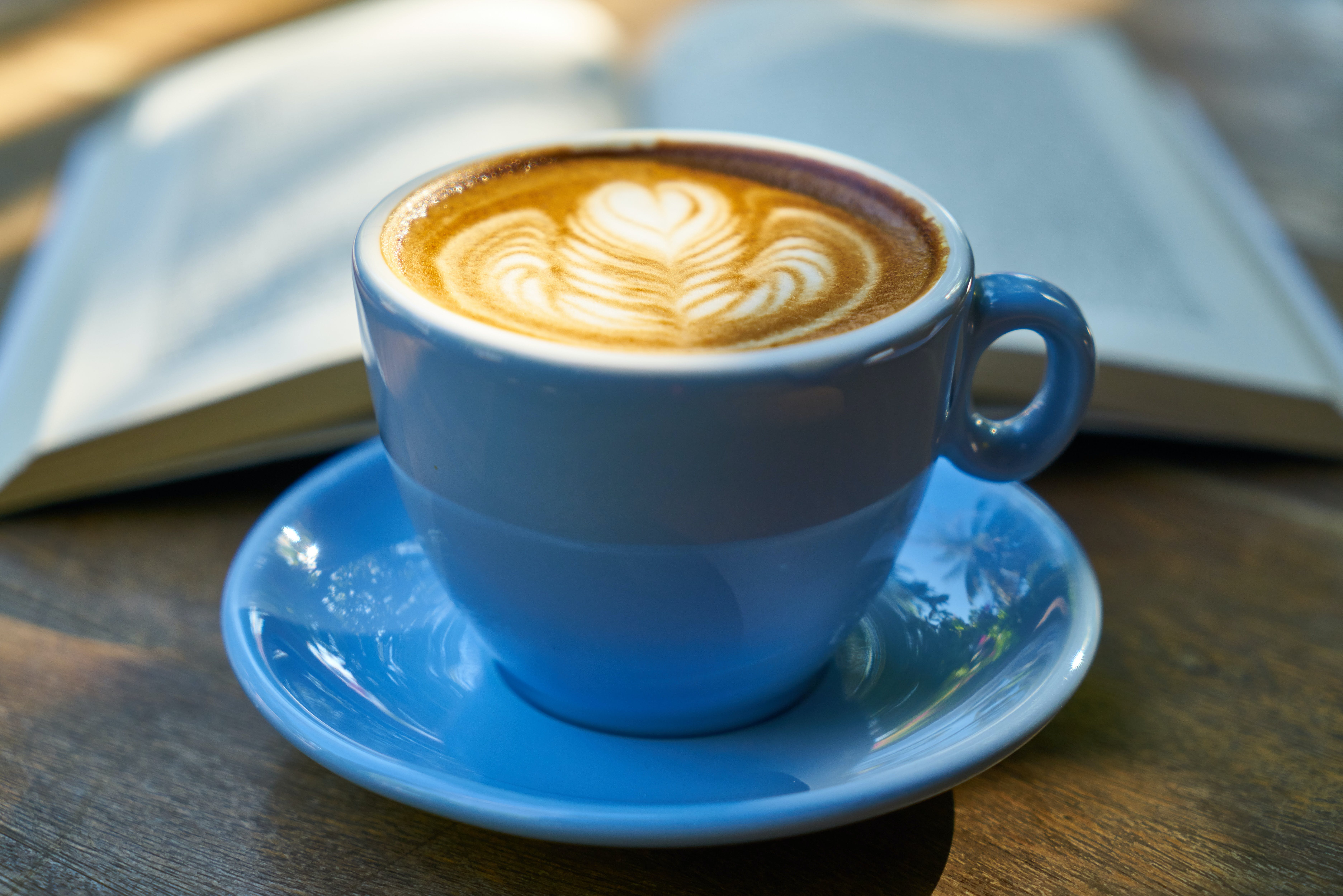 Ceramic Cup Filled With Coffee on Saucer