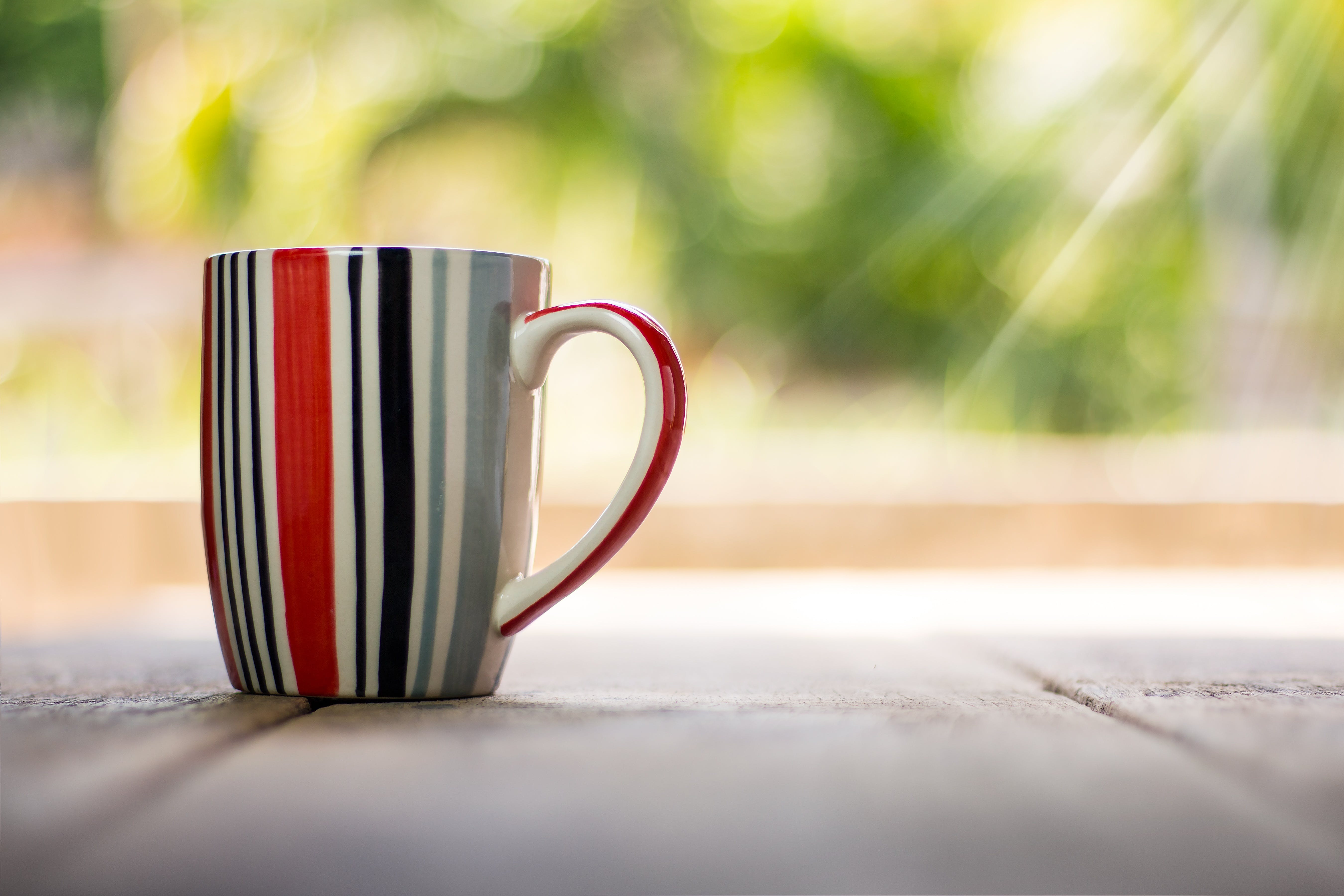 Selective Focus Photography of Mug