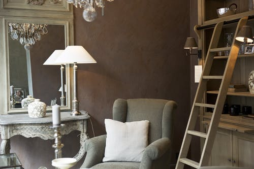 Brown Wooden Ladder Near Gray Armchair