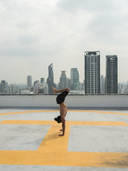 Photo of Man Doing Handstand
