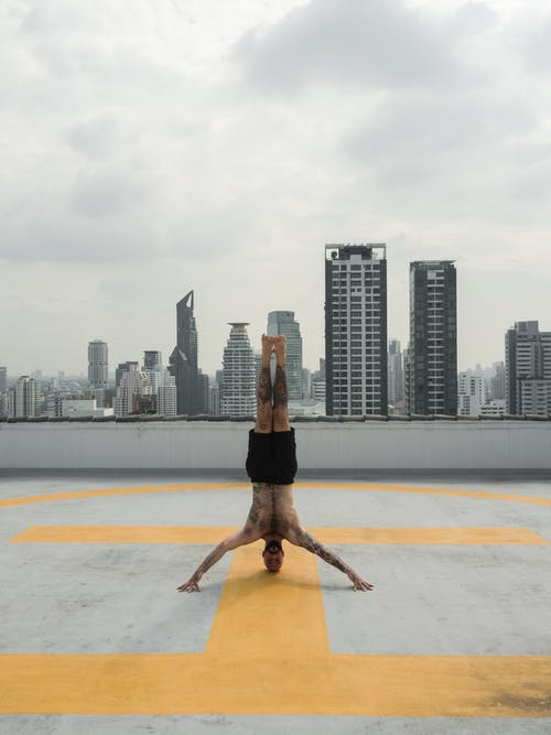 Photo of Man Doing Headstand