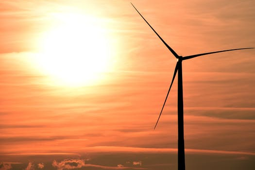 Silhouette Photo Of Wind Energys During Golden Hour 183 Free