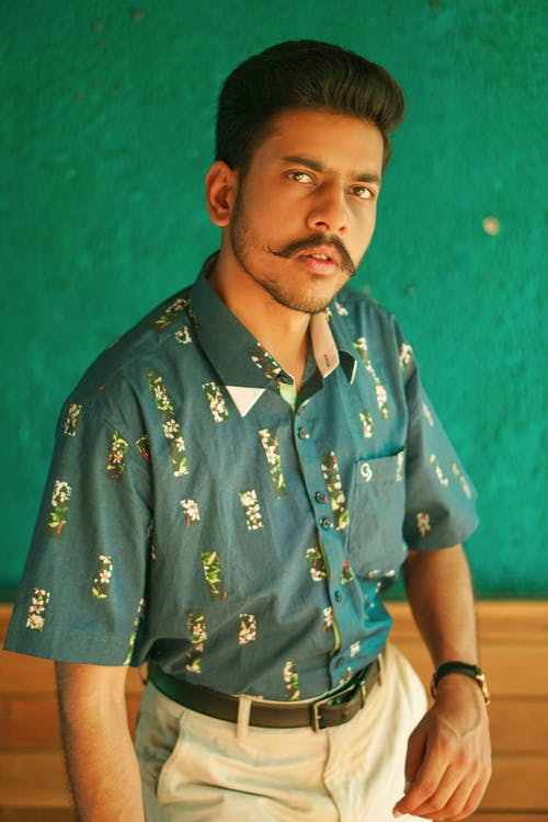 Man in Blue and Yellow Floral Button Up Shirt