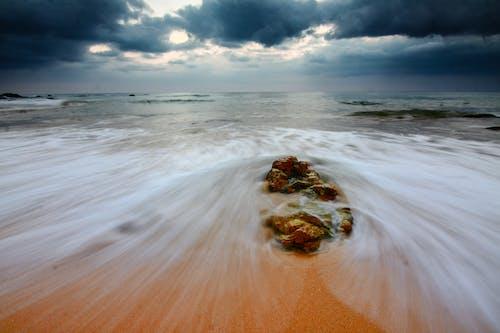 Brown Rock on Sea Shore