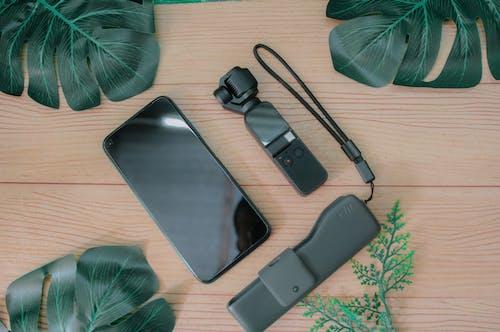 Black Iphone 5 Beside Black Headphones